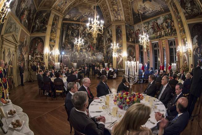 World leaders are seated for a dinner hosted by Dutch King Willem Alexander and Queen Maxima at the Orange Hall in royal palace Huis ten Bosch in The Hague Monday March 24, 2014, at the occasion of the two-day Nuclear Security Summit.
