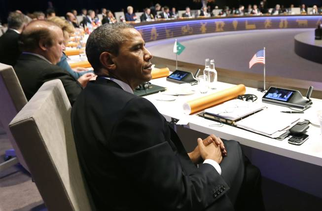 U.S. President Barack Obama attends the opening session of the Nuclear Summit in The Hague, the Netherlands, on Monday, March 24, 2014.