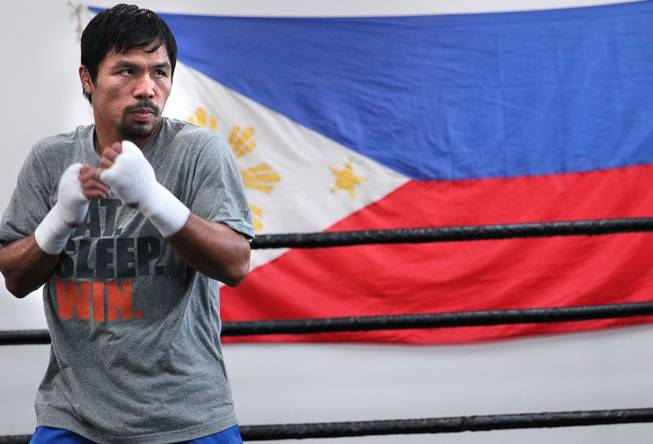 Manny Pacquiao works out at the Wild Card Boxing Club in Hollywood, Calif. during training Monday, March 24, 2014, for his eagerly-anticipated rematch against undefeated WBO World Welterweight champion Timothy Bradley.  .