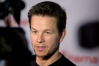 Mark Wahlberg arrives at the opening night presentation and party hosted by Paramount Pictures for 2014 CinemaCon at the Colosseum on Monday, March 24, 2014, in Caesars Palace.