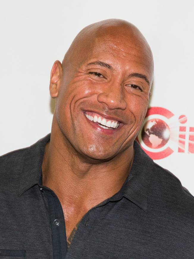 Dwayne Johnson arrives at the opening night presentation and party hosted by Paramount Pictures for 2014 CinemaCon at the Colosseum on Monday, March 24, 2014, in Caesars Palace.