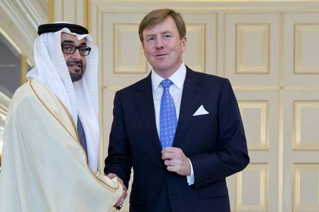 United Arab Emirates Sheikh Abdullah bin Zayed Al Nahyan, left, poses with Dutch King Willem Alexander at royal palace Noordeinde on the last day of the Nuclear Security Summit (NSS) in The Hague, Netherlands, Tuesday, March 25, 2014.