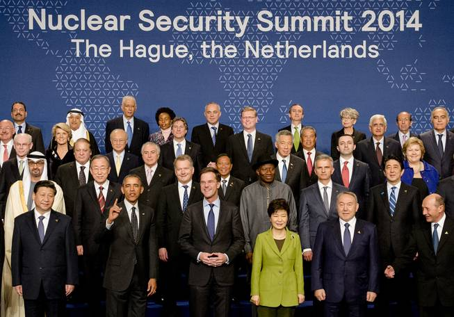 World leaders with U.S. President Barack Obama gesturing, front row second left, pose for a family photo on the last day of the Nuclear Security Summit (NSS) in The Hague, Netherlands, Tuesday, March 25, 2014.