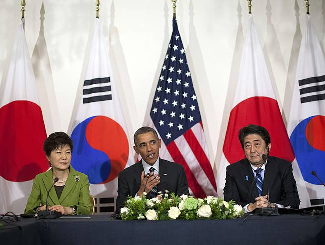 President Barack Obama meets with Japanese Prime Minister Shinzo Abe, right, and South Korean President Park Geun-hye at the U.S. Ambassador's Residence in the Hague, Netherlands, March 25, 2014.
