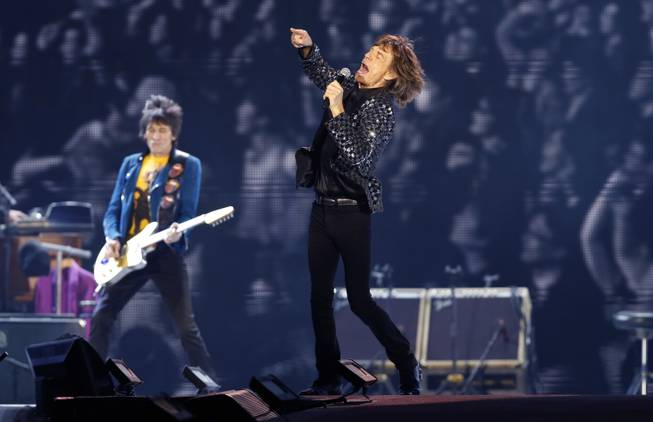In this Feb. 26, 2014, photo, The Rolling Stones perform at the Tokyo Dome in Japan. Israeli concert promoter Shuki Weiss said Tuesday, March 25, 2014, that the legendary band will play in Tel Aviv on June 4.