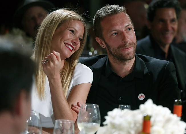 Actress Gwyneth Paltrow and her husband, Coldplay singer Chris Martin, attend the Sean Penn & Friends Help Haiti Home Gala in Beverly Hills, Calif.,on  Jan. 11, 2014. Paltrow and Martin are separating after 11 years of marriage.