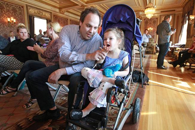 Clinton Atwater plays with his daughter Asia Skye Atwater, 7, before the HB 105 bill signing ceremony at the Utah State Capitol, Tuesday, March 25, 2014, in Salt Lake City.