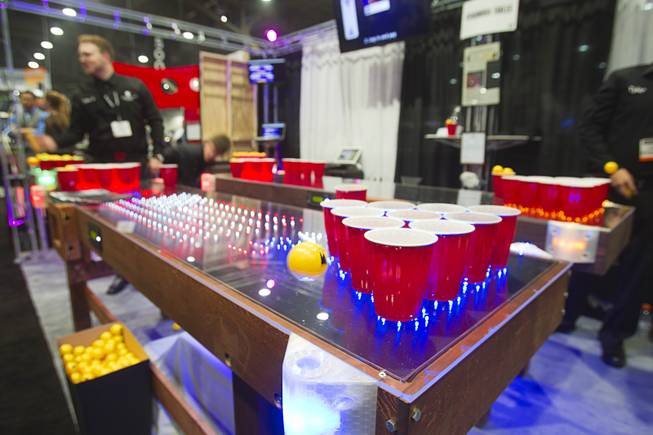 LED beer pong tables by Penumbra Tables are displayed during the Nightclub & Bar Convention and Trade Show at the Las Vegas Convention Center Wednesday March 26, 2014.