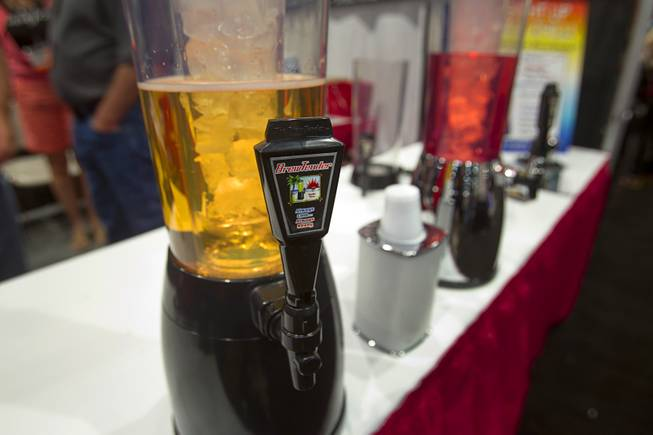 BrewTender beverage dispensers are displayed during the Nightclub & Bar Convention and Trade Show at the Las Vegas Convention Center Wednesday March 26, 2014.  The dispenser comes with an ice chamber to keep the beverage cool.