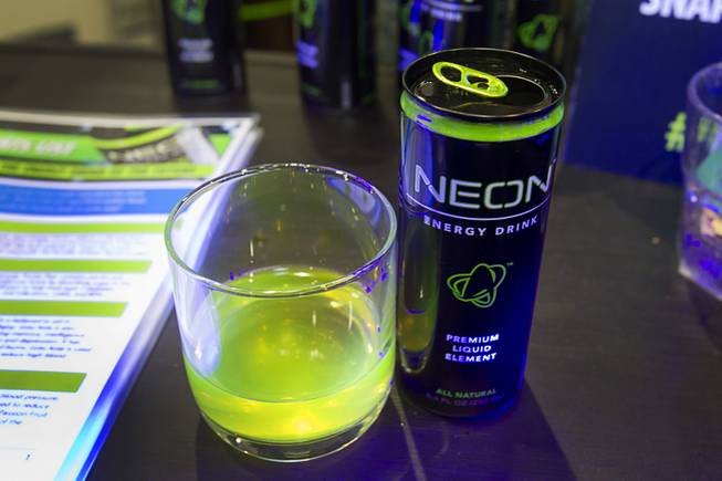 A Neon energy drink glows  under a blacklight during the Nightclub & Bar Convention and Trade Show at the Las Vegas Convention Center Wednesday March 26, 2014.