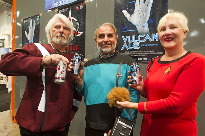 From left, Keith Ogilvie, Bob Brandys, and his wife Gail Brandys pose at the Federation of Beer booth during the Nightclub & Bar Convention and Trade Show at the Las Vegas Convention Center Wednesday March 26, 2014.