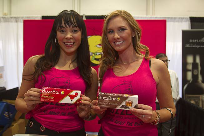Tala Marie, left, and Stacey Kane display Buzz Bars, alcohol-infused ice cream bars, during the Nightclub & Bar Convention and Trade Show at the Las Vegas Convention Center Wednesday March 26, 2014.
