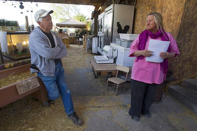 Glenn Linsenbardt talks with his wife, Sharon, about their difficulties in dealing with Clark County regulations at The Farm, 7222 W. Grand Teton Drive, on Wednesday, March 26, 2014.