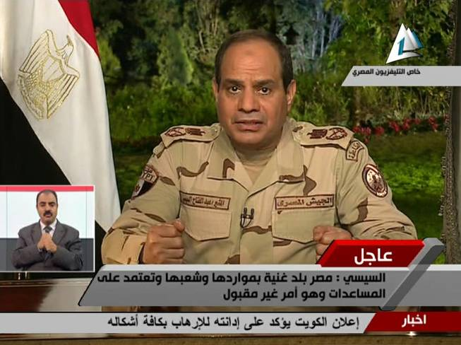 In this image made from video broadcast on Egypt's State Television, Egypt's military chief Abdel-Fattah el-Sissi speaks in a nationally televised speech, announcing that he will run for president, in Cairo, Egypt, Wednesday, March 26, 2014.