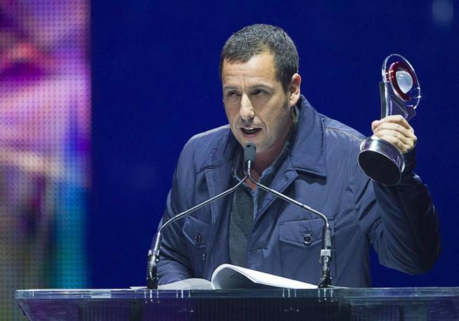Actor Adam Sandler, accepts the award for Male Star of the Year, at the Big Screen Achievement Awards during CinemaCon, the official convention of the National Association of Theatre Owners, at Caesars Palace Thursday, March 27, 2014.
