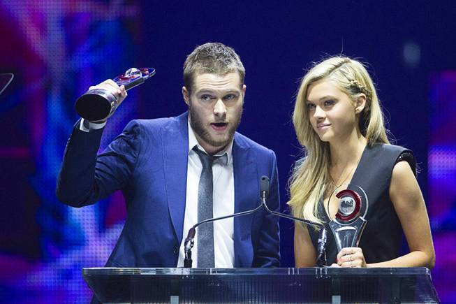 Jack Reynor (L) and Nicola Peltz, Rising Stars of 2014, accept their awards at the Big Screen Achievement Awards during CinemaCon, the official convention of the National Association of Theatre Owners, at Caesars Palace Thursday, March 27, 2014.