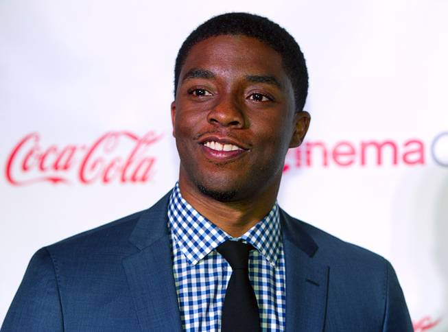 Actor Chadwick Boseman, recipient of the Male Star of Tomorrow award, arrives for the Big Screen Achievement Awards during CinemaCon, the official convention of the National Association of Theatre Owners, at Caesars Palace Thursday, March 27, 2014.