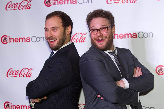 Evan Goldberg (L) and Seth Rogen, recipients of the Comedy Filmmakers of the Year award, arrive for the Big Screen Achievement Awards during CinemaCon, the official convention of the National Association of Theatre Owners, at Caesars Palace Thursday, March 27, 2014.