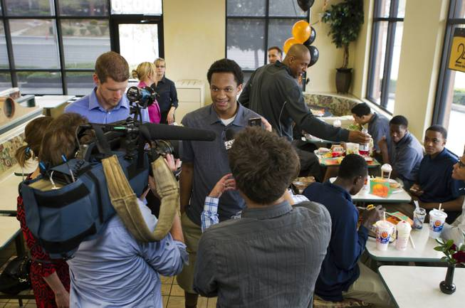 Findlay Prep guard Rashad Vaughn is interviewed by members of the media while dining with teammates at a local McDonald's on Thursday, March 27, 2014.  He is the star of UNLV basketball's 2014 recruiting class and now honored as a McDonald's All-American.