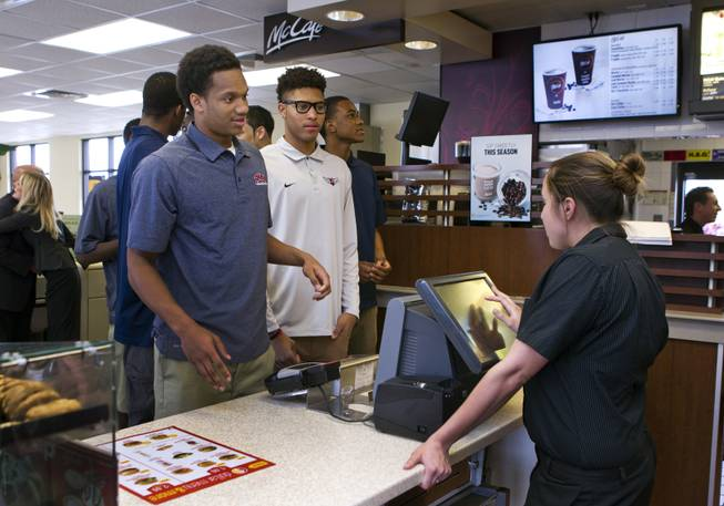 Findlay Prep guard Rashad Vaughn orders food with teammates while dining at a local McDonald's as he is honored for being selected as a McDonald's All-American on Thursday, March 27, 2014.