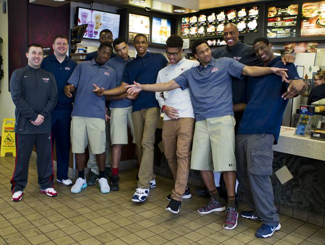 Findlay Prep players and coaches gather with teammate  Rashad Vaughn at a local McDonald's to honor him being  selected as a McDonald's All-American on Thursday, March 27, 2014.