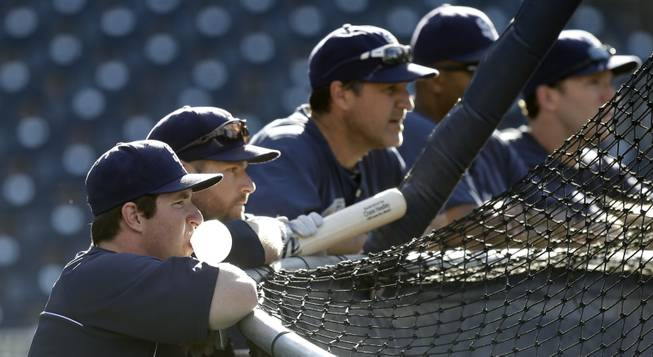 San Diego Padres' Jedd Gyorko blows a bubble as he and teammates line the back of the hitting cage prior to a baseball game between the Padres and Arizona Diamondbacks Tuesday, Sept. 24, 2013, in San Diego.