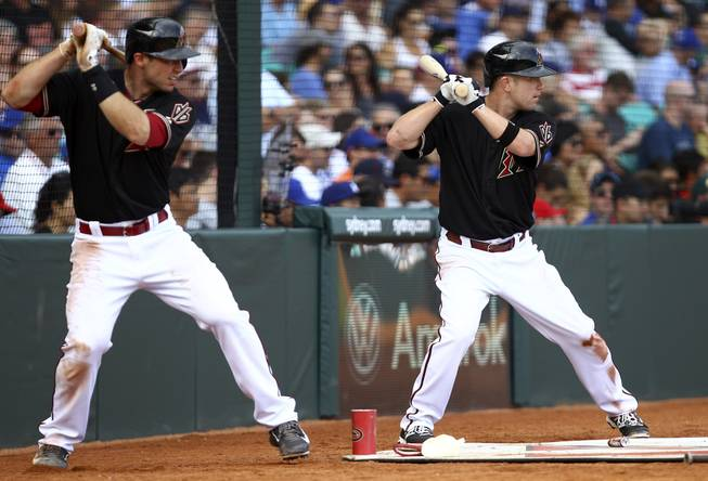 Arizona Diamondbacks' Paul Goldschmidt, left, and Aaron Hill prepare to hit during the second game of the two-game Major League Baseball opening series between the Los Angeles Dodgers and Arizona Diamondbacks at the Sydney Cricket ground in Sydney, Sunday, March 23, 2014. The Dodgers won the game 7-5 and the series 2-0.