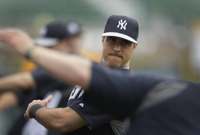 New York Yankees first baseman Mark Teixeira stretches before batting practice of a spring exhibition baseball game against the Pittsburgh Pirates in Bradenton, Fla., Monday, March 17, 2014.