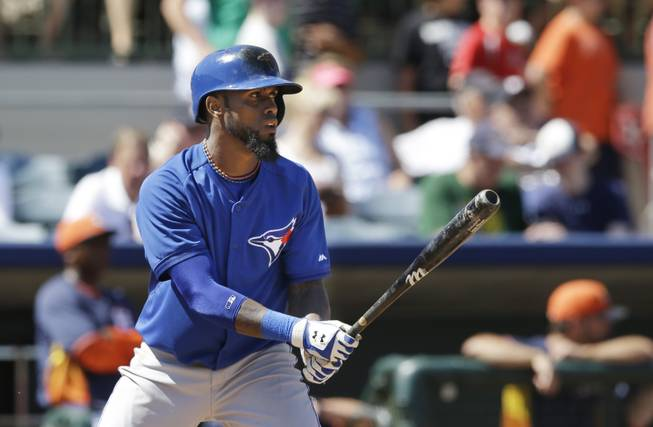 Toronto Blue Jays' Jose Reyes bats during a spring training baseball game against the Houston Astros in Kissimmee, Fla., Sunday, March 9, 2014