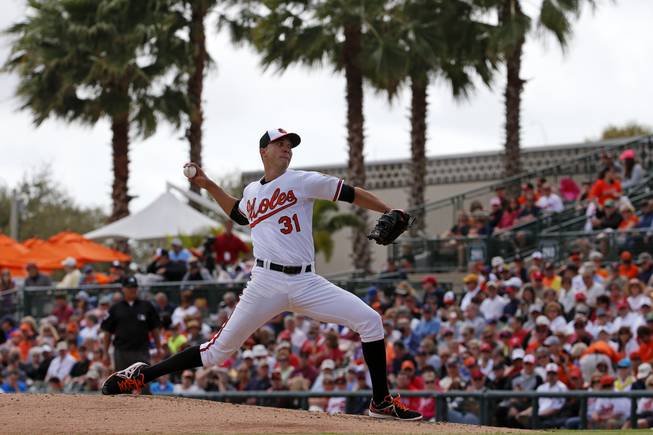 Baltimore Orioles starting pitcher Ubaldo Jimenez (31) throws in the first inning of an exhibition spring training baseball game against the Philadelphia Phillies in Sarasota, Fla., Friday, March 7, 2014.