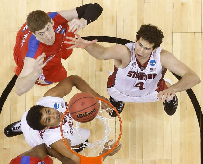 Stanford center Stefan Nastic (4) and Dayton forward/center Matt Kavanaugh (35) vie for a loose ball during the first half in a regional semifinal game at the NCAA college basketball tournament, Thursday, March 27, 2014, in Memphis, Tenn.