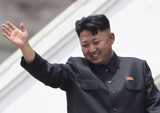 In this July 27, 2013, file photo, North Korean leader Kim Jong Un waves to war veterans during a mass military parade celebrating the 60th anniversary of the Korean War armistice in Pyongyang, North Korea. Despite thinly sourced reports that an order went out in mid-March 2014 for university students to buzz cut the sides of their heads just like North Korea's supreme leader, recent visitors to the country say they haven't seen evidence of any mass haircutting.