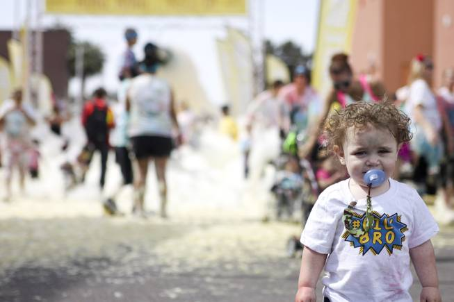 A.J. Staley stands in front of the yellow foam bog station during the 5k Bubble Run in downtown Las Vegas Saturday, March 29, 2014.