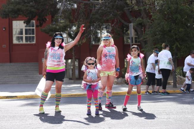 A group of participants pose for the camera during the 5k Bubble Run in downtown Las Vegas Saturday, March 29, 2014.