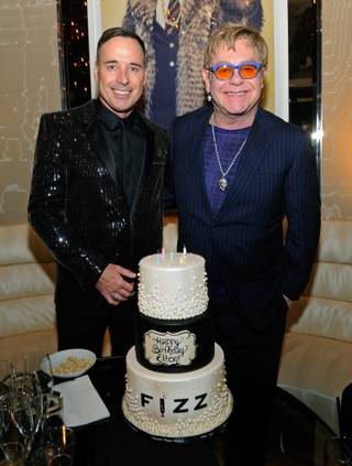 Sir Elton John, right, with David Furnish, celebrates his 67th birthday at Fizz on Friday, March 28, 2014, at Caesars Palace.