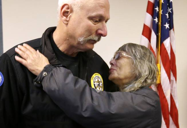 In this March 26, 2014, file photo, Robin Youngblood, right, smiles after embracing Snohomish County helicopter crew chief Randy Fay, who helped rescue her from the scene of a deadly mudslide days earlier, in Arlington, Wash. Youngblood was home when the mudslide hit, moving her house a quarter-mile before she was able to find her way out of the rubble.