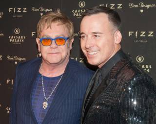 Sir Elton John and David Furnish attend the official grand opening of Fizz on Friday, March 28, 2014, at Caesars Palace.