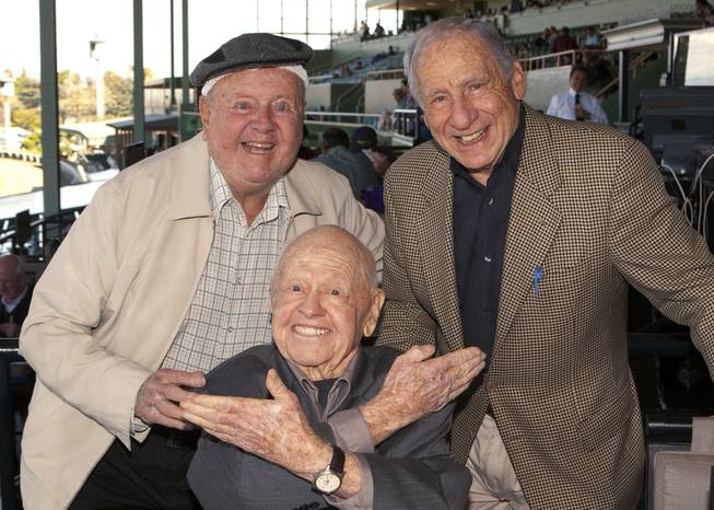In this Sunday, March 30, 2014, file photo, entertainment icons Dick Van Patten, left, and Mel Brooks flank Mickey Rooney at Santa Anita Park, in Arcadia Calif. Rooney, a Hollywood legend whose career spanned more than 80 years, has died. He was 93. Los Angeles Police Commander Andrew Smith said that Rooney was with his family when he died Sunday, April 6, 2014, at his North Hollywood home.