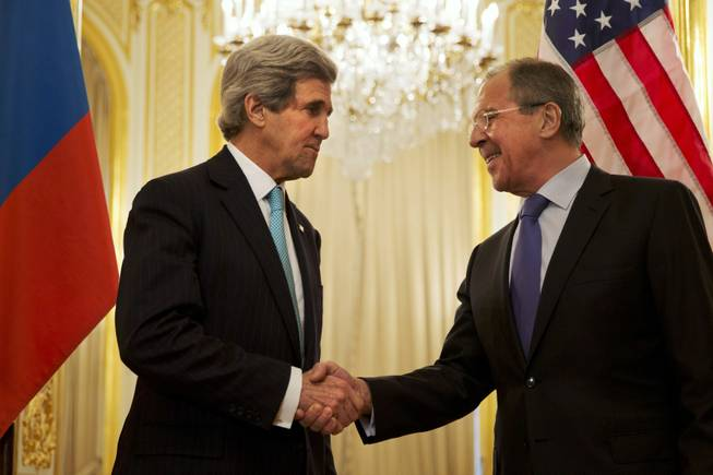 U.S. Secretary of State John Kerry, left, shakes hands with Russian Foreign Minister Sergey Lavrov before the start of their meeting at the Russian Ambassador's residence about the situation in Ukraine, in Paris Sunday March 30, 2014. Kerry traveled to Paris for a last minute meeting with Lavrov.