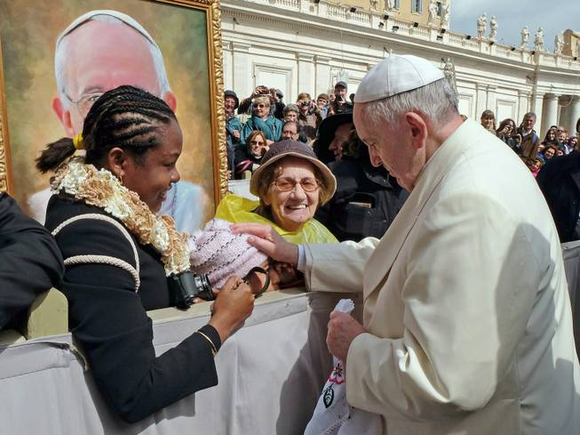 In this photo provided by Catholic Coalition of Immigrant Rights, Pope Francis touches 10-year-old Jersey Vargas, who traveled to the Vatican from Los Angeles to plead with him to help spare her father from deportation, during a public audience at St. Peter's Square in Vatican City. Her father, Mario Vargas, in the United States illegally, had been in federal custody and faced possible deportation. After speaking with Francis, Mario Vargas was released on bond from immigration detention, Immigration and Customs Enforcement said Friday, March 28, 2014. Jersey Vargas was part of a California delegation that sought to encourage the Vatican to prod President Obama on immigration reform.