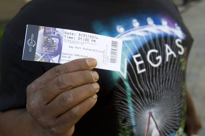 Entertainer Larry Edwards displays a ticket for the first public ride on the 550-foot-tall High Roller observation wheel Monday, March 31, 2014. The observation wheel, the tallest in the world, is part of the Linq project, a $550 million development by Caesars Entertainment Corp.