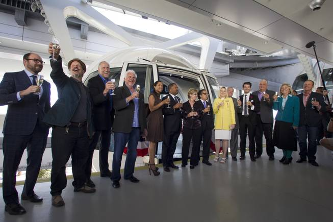 Special guests, executives and elected officials toast before the first official ride on the 550-foot-tall High Roller observation wheel Monday, March 31, 2014. The observation wheel, the tallest in the world, is part of the Linq project, a $550 million development by Caesars Entertainment Corp.