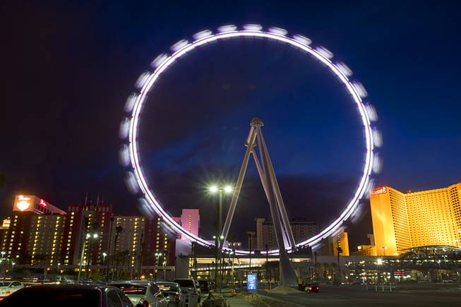 The 550-foot-tall High Roller observation wheel turns in the evening Monday, March 31, 2014. The observation wheel, the tallest in the world, is part of the Linq project, a $550 million development by Caesars Entertainment Corp.  The ride is now open to the public.