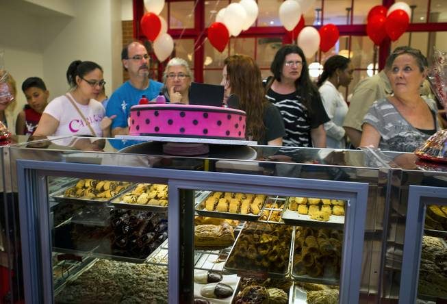 Customers order from the new Carlo's Bakery in the Venetian as they celebrate their grand opening on Monday, March 31, 2014.