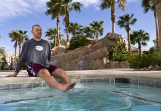 Brendan Remple with the Las Vegas Wranglers Professional Hockey Club soaks his sore legs in the hot tub at his condo complex on Tuesday, April 1, 2014.
