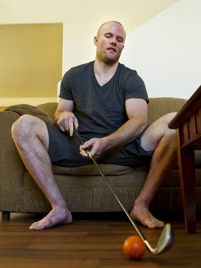 Geoff Irwin with the Las Vegas Wranglers Professional Hockey Club likes to stay sharp at home by tapping a ball around while watching hockey on television Tuesday, April 1, 2014.