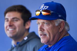 Wally Backman, right, manager of the Las Vegas 51s, watches players with athletic trainer Joseph Golia during practice at Cashman Field on Tuesday, April 1, 2014.