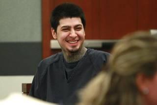 Peter Andrade Jr. smiles before his preliminary hearing on attempted murder and other charges Tuesday, April 1, 2014.