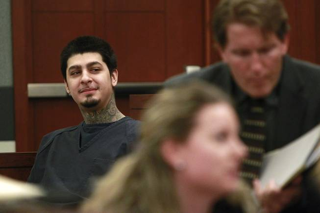 Peter Andrade Jr. smiles in the direction of his girlfriend who is sitting in the gallery before his preliminary hearing on attempted murder and other charges Tuesday, April 1, 2014.