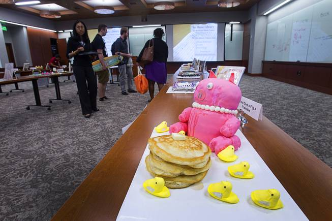 "A creation by Tia Donjon and Stacie Mitchell is displayed during the 2014 Edible Book Festival at the UNLV Lied Library Tuesday, April 1, 2014. The creation was inspired by the children's book ""If You Give A Pig A Pancake"" by Laura Numeroff."